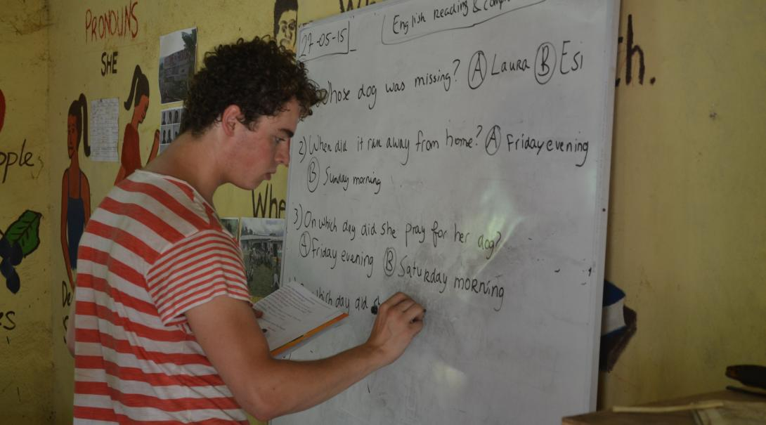 A Projects Abroad teaching volunteer prepares some English exercises for the class in Ghana.